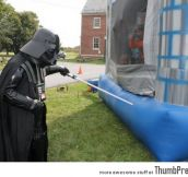 Darth Vader is frightening the kids in bouncing house.
