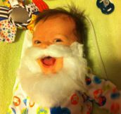 Apparently my 2 month old son really likes Santa's beard…