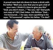 Dad gives something to his son…