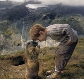 An adorable little boy, a curious marmot, and a dramatic landscape…