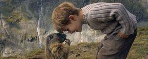 An adorable little boy, a curious marmot, and a dramatic landscape…