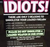 Sign on a gun store's front door…