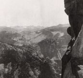 Two ladies do high kicks while posing atop Overhanging Rock at Glacier Point in the Yosemite National Park, 1900
