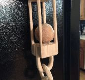 Carved this out of a solid block of wood. A caged ball and chain.