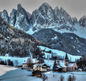 Winter at the Italian village of Funes at the base of the Dolomites