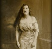 This funny portrait of a woman was taken while she was mid-sneeze. (1900)