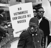 Demonstrator at the Harlem Peace March to end racial oppression carries an anti-war sign, 1967