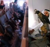This guy buys a whole row for his falcons to fly in 1st class