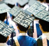 Students wear how much debt they are in on their graduation caps.