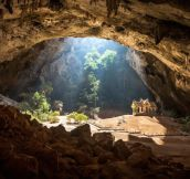 Amazing cave in Thailand. Yes, that is a buddhist temple inside the cave.