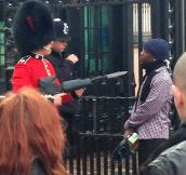 A Coldstream Guard pointing his bayonet at a man after he argued with the police officer and tried to force his way into the palace on Friday.