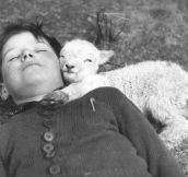Kid With Baby Goat, Circa 1940