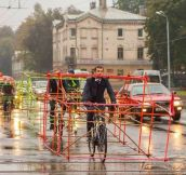Latvian cyclists craft car skeletons to critique vehicle size on roads