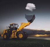 Awesome Photo Of A Tractor Catching A Cloud