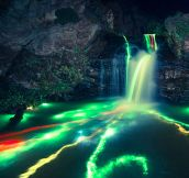 Long Exposure Of Glowsticks In A Waterfall