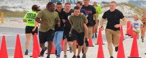 Marines Help A Boy Cross The Finish Line
