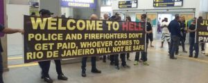 Brazilian cops and firefighters protest in the airport for incoming tourists