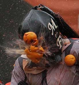orange throwing1 The 10 Weird Festivals Where People Throw Things At Each Other