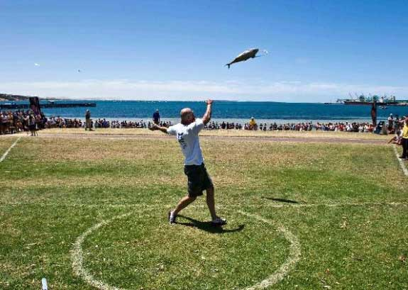 tuna throwing The 10 Weird Festivals Where People Throw Things At Each Other