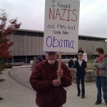 Old man with rally sign