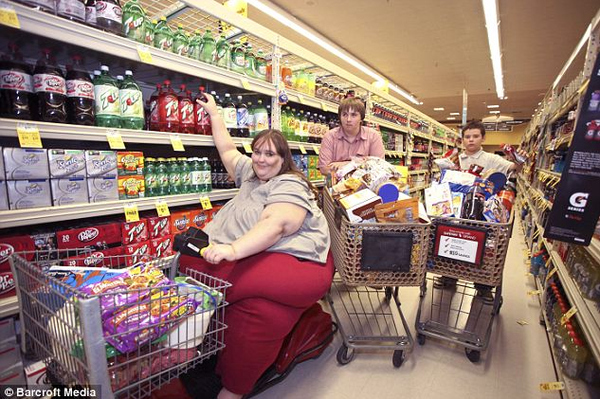 Susan Eman and her two sons stock up for that day's meal.