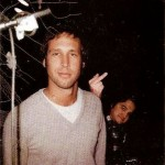 John Belushi photobombing Chevy Chase.