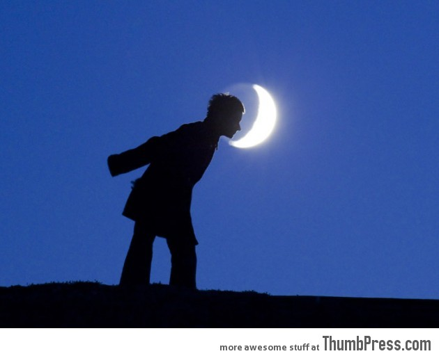 Moon Madness: 20 Photos of People Posing with The Moon and Having Fun