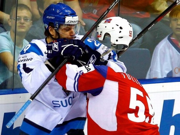 The hockey player in blue did not punch the head off the hockey player in red.