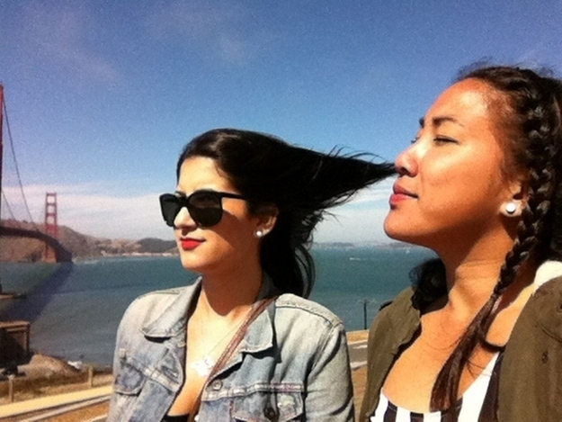 This woman is not snorting her friend's hair.