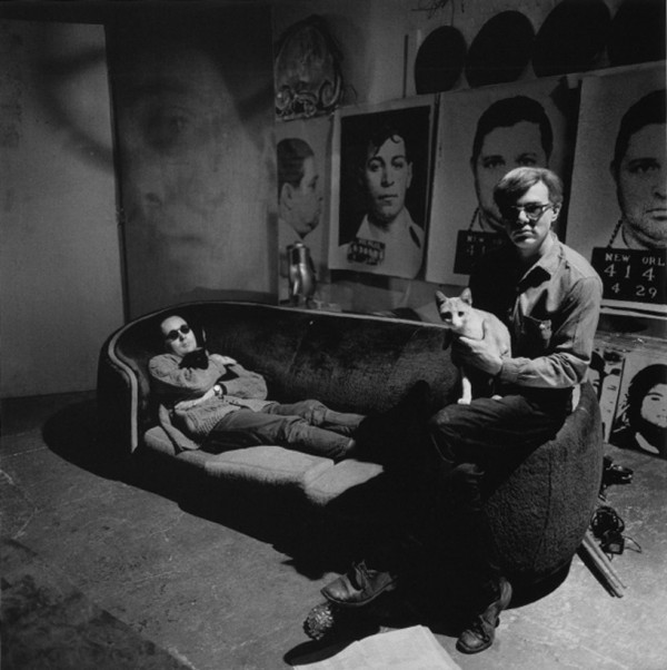 Artist Andy Warhol in his studio with robert indiana and his cat