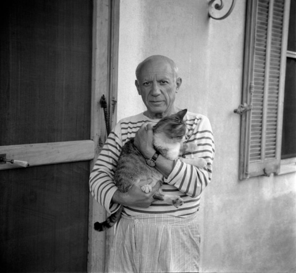 Artist Pablo Picasso with his cat