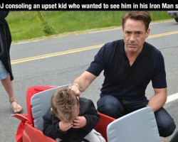 Robert Downey, Jr. Consoling an upset kid who wanter to see him in his Iron Man suit...