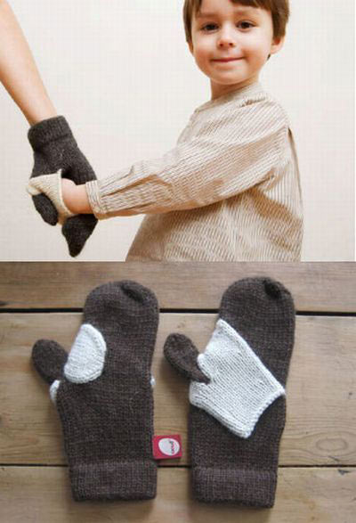 cute-hand-holding-mittens-kid