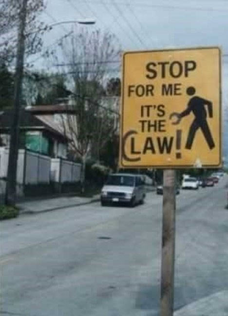 funny-claw-stop-sign-road