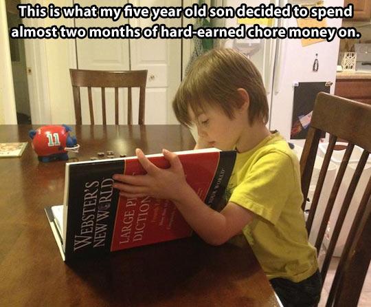 funny-kid-reading-dictionary-money