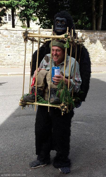 funny-monkey-costume-man-cage