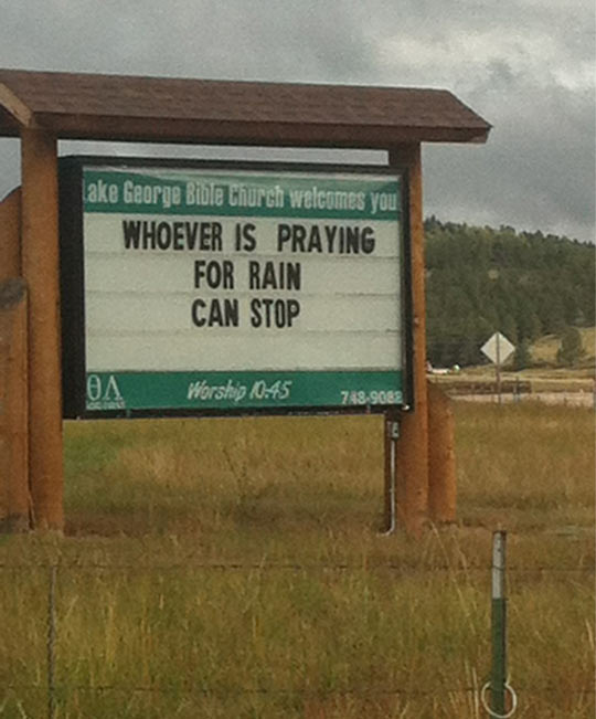 funny-sign-praying-rain-stop