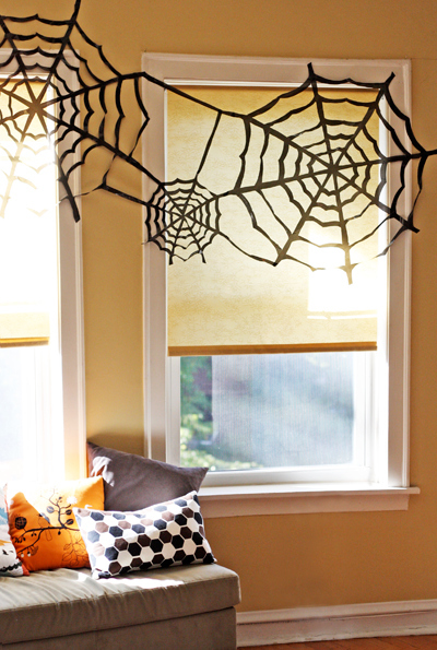 Expectation - Trash bag spider web window décor.