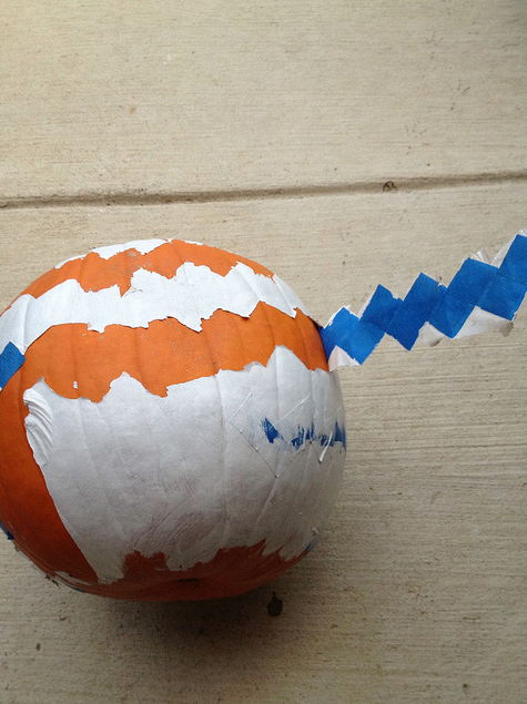 Reality - Chevron painting pumpkins.