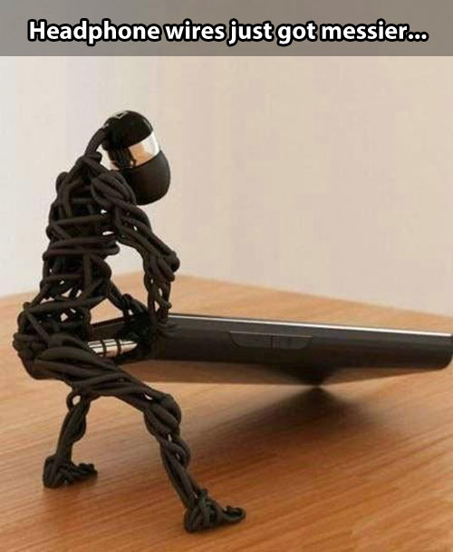 funny-headphones-man-phone-table