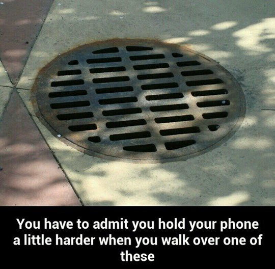 funny-sewer-hold-phone-hard-walking