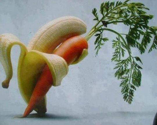 A banana, tenderly holding a carrot…