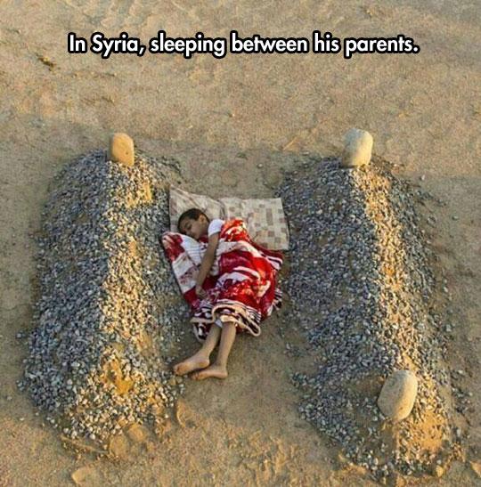 kid-sleeping-sand-between-parents-graves