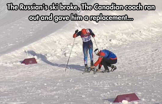 Canadian coach helping out a Russian during a race…