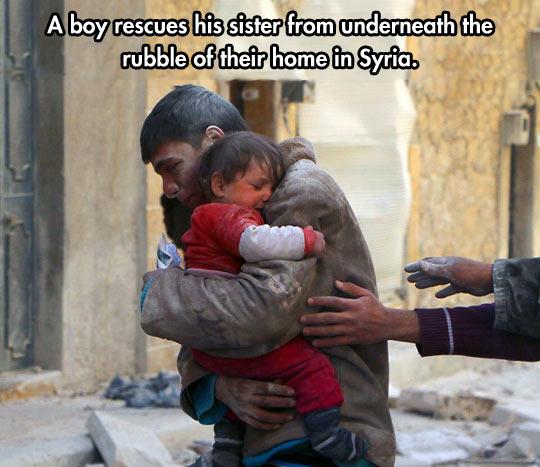 funny-Syria-boy-rescue-sister-rubble