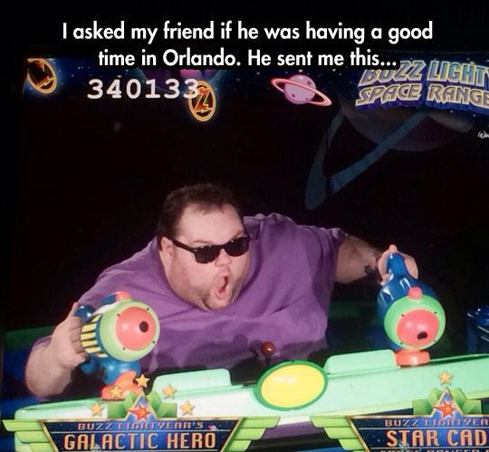 funny-fat-guy-having-fun-Buzz-Lightyear-game