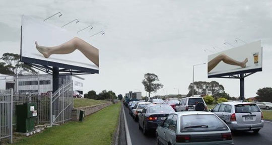 funny-lube-ad-sign-legs-traffic
