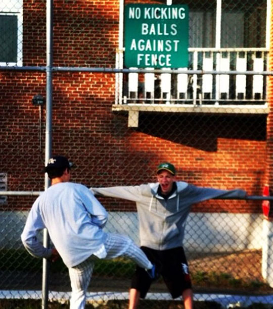 funny-sign-kicking-prohibited-fence-teenagers