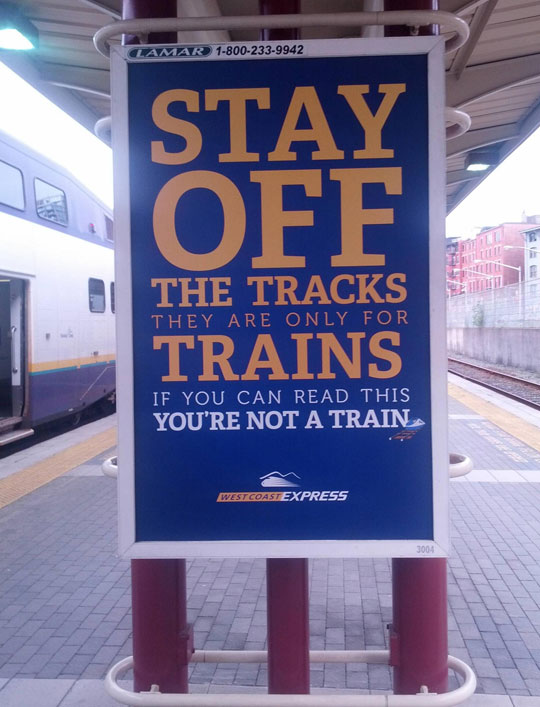 funny-train-as-sign-tracks-reading