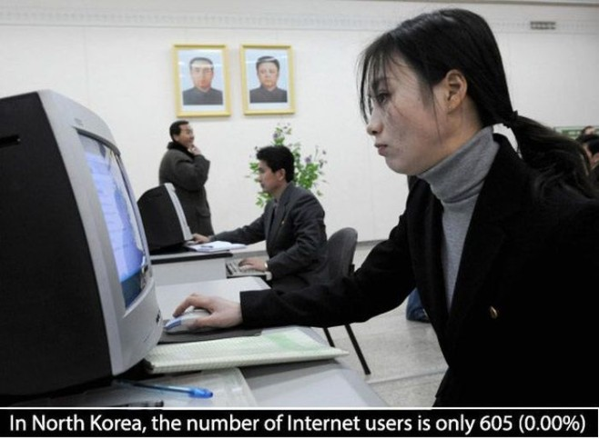A North Korean woman uses a computer in